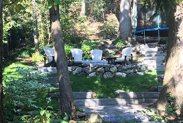 cottage chairs in backyard landscape